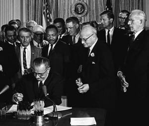 800px-Lyndon_Johnson_signing_Civil_Rights_Act,_July_2,_1964