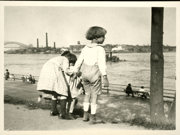 Frank M. Ingalls, New York City: three unidentified small children looking out over the East River, undated. 	Frank M. Ingalls photograph collection, 1901-2155, New-York Historical Society