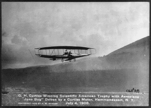 a postcard showing Glenn Curtiss's June Bug Flight in Hammondsport, NY 1908