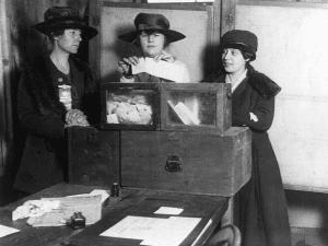 three suffragist casting votes in 1917