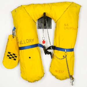 Raincoat, metal, ink, thread, paper, strapping