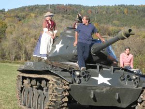 visitor rides korean war tank at old stone fort history fair