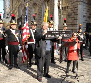 city-of-new-york-councilmember-margaret-chin-and-lower-manhattan-historical-society-co-founder-james-kaplan-unveiled-an-evacuation-day-plaza-sign