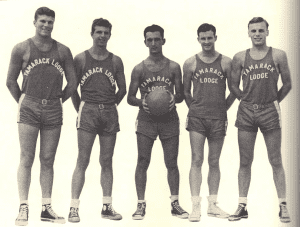 Holy Cross (and future Boston Celtics) starBob Cousy (center) and his Tamarack Lodge.png
