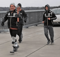 Johnny Vacca carries the torch across the Walkway Over the Hudson with Clayton DeClemente