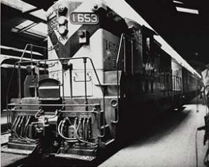 CNW Locomotive #1653 at platform in passenger terminal