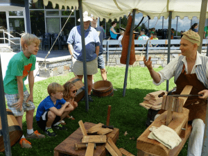 A barrel maker interacts with visitors at Saratoga NHP Army Trades Weekend