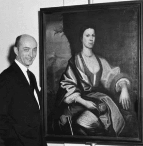 Norman S. Rice in front of a portrait of Engeltje Wendell in 1966