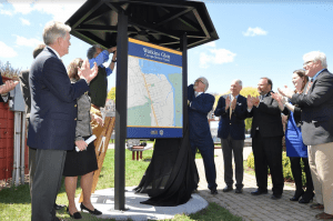Representatives unveil the new sign at Seneca Waterfront Park in Watkins Glen