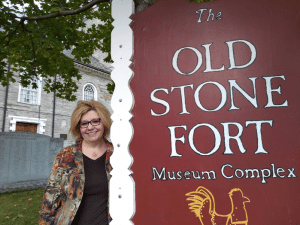 Melinda McTaggart stands outside the Old Stone Fort Museum