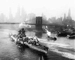 Damaged French battleship Richelieu, heading for repairs, passes Brooklyn Bridge, 1943