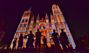 projection mapping of stained glass imagery on the Notre Dame Cathedral in Rouen France
