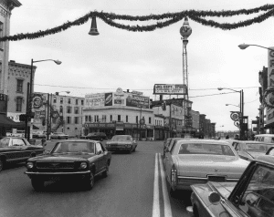 View down Glen Street toward Boxers Drug Store on the intersection of Glen and Warren Streets in late November 1968