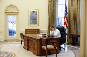 President Barack Obama at work in the Oval Office besides Hassams painting