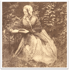 Mrs Seward reading in her gardens courtesy Seward House Museum