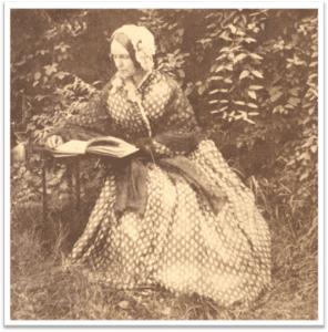 Mrs Seward reading in her gardens courtesy Seward House Museum
