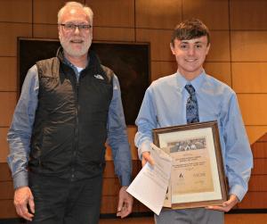 Cole Siebels receiving his award