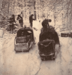 Snowmobilers clear a trail near Nicks Lake in the winter of 1966-67