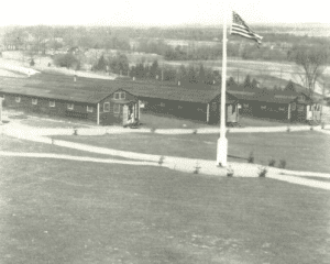 Deansboro CCC Camp flag pole and three buildings