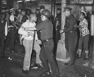 Policemen with African American protesters during the Bedford–Stuyvesant riot of 1964